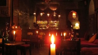 The bar area is mostly lit just with laterns and candlelight.